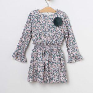 Vestido estampado floral con pompón.
